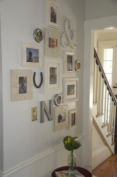Photo wall - I would love something like this in my living room. Stairwell Pictures, Picture Arrangements, Interior And Exterior, Interior Design, Inspiration Wall, My Living Room, Wall Decor, Wall Art, Apartment Living