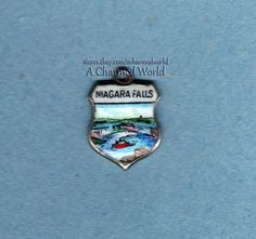 Vintage Enamel Sterling Silver Maid of the Mist Niagara Falls Shield Charm - $44.95US (offers considered)
