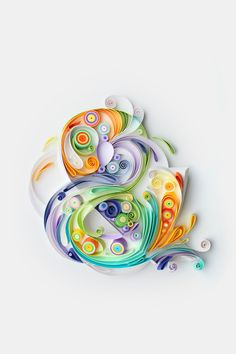YULIA BRODSKAYA is well-known for her paper graphics or 'quilling' (rolled paper glued on it's edge)