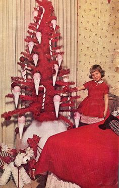 Bright red tree with ice cream cones and candy canes.