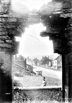 WWI, July 1917; German soldier standing at the ruins in the village of Givonne. ©IWM Q 29879
