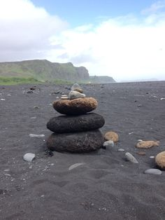 Black sand beach in Iceland - rock stacking