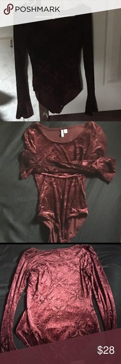 """Burgundy Velvet-Flocked Bodysuit This is a beautiful burgundy velvet-flocked bodysuit by Cato. The fabric is quite see-through (though less so than the picture when it's on). It has small bell sleeves and a scooped neckline, and it snaps closed at the bottom. The first two photos aren't in natural light, but the rest are. Measurements: Pit to pit: 26"""": Waist: 18""""; Length: 25"""" Tags: velvet red burgundy flocked bodysuit cute goth gothic gothy Cato Tops"""