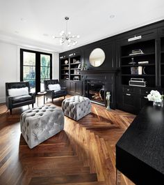 The Design Company - dens/libraries/offices - hardwood floors, herringbone hardwood floors, white walls, white wall color, built-ins, black ...