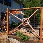 Deer fence with copper sculpture