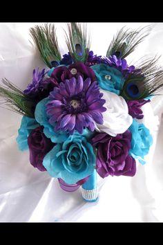 Peacock wedding bouquet! LOVE!