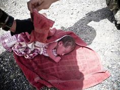 Sept. 19, 2012. (It can be very dangerous being born a girl. #gendercide) NATO's International Security Assistance Force (ISAF) shows a 4-day old baby girl found at a road side in Ghazni, Afghanistan. The girl, named Pola by the soldiers, has been entrusted to Afghanistan State authorities.