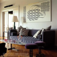 Mod plush tufted velvet sofa with purple accents. www.sukio.com