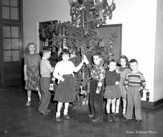 "Vintage Christmas Photograph ~ ""A group of Louise Crawford school pupils are caught by the Tribune photographer in the act of decorating their Christmas tree with mittens.  The mittens are to be sent to children in foreign countries."" * The Ames, IA Tribune ©December 12, 1950"