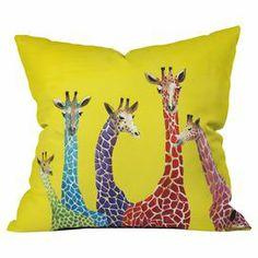 Fun pillow with a giraffe motif by artist Clara Nilles from DENY Designs