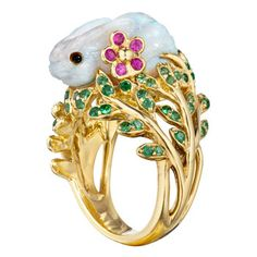 "Mimi So Carved Opal & Gem-Set Bunny Ring ""Fernita"" carved white opal bunny ring in yellow gold, perched atop a tsavorite garnet-encrusted foliate mount, with two pink sapphire floral accents. Handcrafted in New York City. Designed by Mimi So. Opal Jewelry, Fine Jewelry, Jewelry Box, Jewellery, Jewelry Ideas, Animal Jewelry, Animal Rings, Pomellato, American Jewelry"