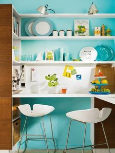 Vibrant color / workstation with open shelving in a small kitchen.