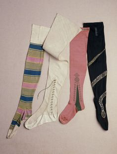 Silk stockings, ca. 1900 - Paris. Given to the Victoria and Albert Museum by The Dowager Lady Swaythling.  Three-color stripes?? Beaded snakes??!! These women had a love of color and a sense of humor.