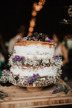 Lavender and baby's breath nearly-naked two tier wedding cake | image by India Earl