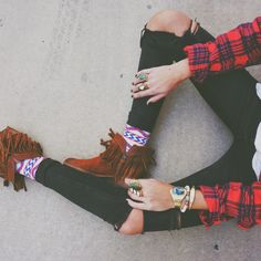 The shirt, the bling, the jeans, the socks, the mocs....all of this out together is a great mix of punk grunge bohemian!