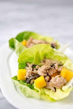 Chicken Mango Lettuce Wraps ~ Light and nourishing, lettuce wraps with stir fried chicken, shiitake mushrooms, and diced mango. ~ SimplyRecipes.com