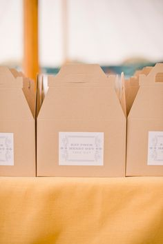 """""""Eat your heart out""""  to-go boxes for favors.  Photo by Jeremy Harwell."""