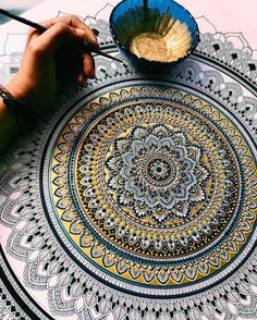 We've been enjoying UK-based artist Asmahan A. Mosleh's Instagram account for a while now. Her intricate mandalas, gilded with gold, can take from 8 t...