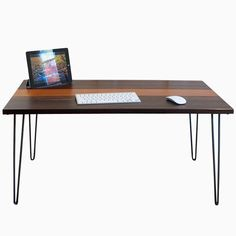 The Cielo- Mid century modern desk featuring black walnut & Leopard wood top with hairpin legs, Entry Way Table,  Free Shipping by BlowingRockWoodworks on Etsy https://www.etsy.com/listing/232715619/the-cielo-mid-century-modern-desk
