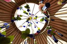 Our hanging blue bottles in our beautiful tent! Neal's Yard Remedies at Wilderness Festival www.nealsyardremedies.com