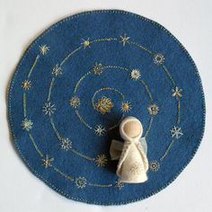 Advent Calendar centerpiece with embroidered star spiral and Waldorf inspired angel pegdoll