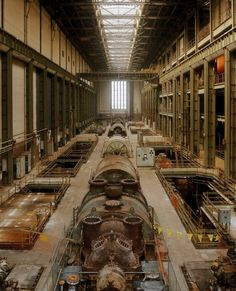 """Taken before Tate Modern opened, here's the Turbine Hall as it once was... which is to say, filled with turbines! The only recognisable thing, other than the size of the space, is the tall window at the far end."""