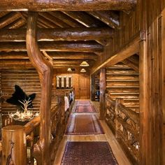 Catwalk is open to below on both sides.  Custom railing utilizes twigs and they comfort you through your journey. ~ www.cedarhomes.com