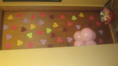 .... Valentines Morning SURPRISE! Stenciled conversation heart candies and stuck them to the door with tape,balloons and some treats! tada!