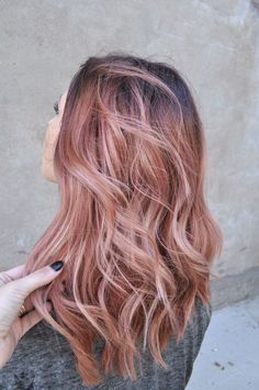 Pink rose gold hair. Waves haircut.