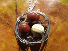 $23 - www.etsy.com/shop/JustHeathersJewelry - Bird's nest necklace - wire wrapped - brown and tan swirl beads - birdnest - robins egg nest - ceramic - glass - gift idea - handmade. Use coupon code PINS15 for 15% off your total purchase.