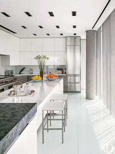 The same curtains line the sleek kitchen | archdigest.com