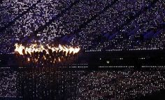 The Olympic flame burns during the closing ceremony of the London 2012 Olympic Games