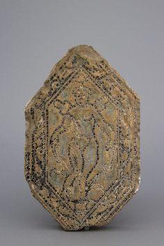 Impressed with a central cherub on a ground, surrounded  by a frame of foliage. Traces of black glaze. Tiles of this type are attributed to the French region of Brémontier-Massy.  Ex-collection J.W.N. Van Achterberg. Size: ca. 19 x 10,5 cm Ref: J. Cartier, Céramiques de l?Oise, Somogy, 2001, p83 & 85, catalogue n°362-375, pp96-97 ; C. Norton, Carreaux de pavement du Moyen-âge et de la Renaissance, Catalogue d?Art et d?histoire du Musée Carvalet, VII, 1992, pp146-147 ; Benoît Faÿ, Le monde…