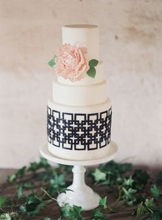 The interlocking black-and-white pattern on this cake, made by Fresh Bakes, reflected the theme of two families becoming forever intertwined through the marriage of their children. | Photo by Lissa Ryan Photography | Concept, styling, and orchestration by Orchestrated Stylized Shoots