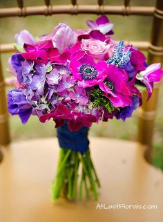Unique wedding flowers. Vibrant Wedding Bridal Bouquet Purple, Navy Blue, Fuchsia and Gold Wedding Inspiration. Orchids, Hydrangea and Anemones. Classic; Unique Wedding Flowers  Floral Design by At Last Florals Image by Woodland Fields