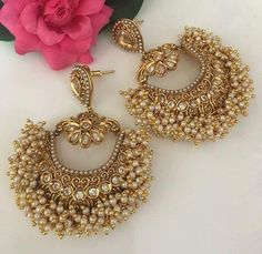 Art deco jewelry is a rare combination of aristocratic preferences with a modern touch that enhances the individuality of its wearers. Indian Jewelry Earrings, Indian Jewelry Sets, Jewelry Design Earrings, Indian Wedding Jewelry, Gold Earrings Designs, Ruby Jewelry, Ear Jewelry, Bridal Jewelry, Silver Necklaces