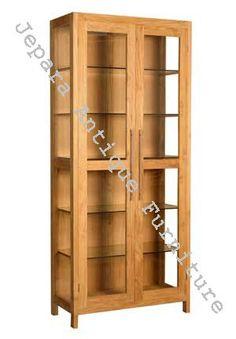 Rak Buku Lemari Pajangan kayu jati ini memang dikombinasikan dengan kaca, sehingga mampu memberikan nuansa yang indah pada sebuah rak buku maupun lemai pajangan yang bisa anda gunakan untuk melengkapi ruangan rumah anda.