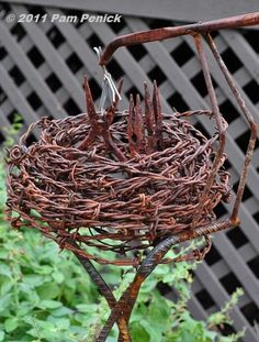 Dishfunctional Designs: Beautiful Upcycled Barbed Wire Creations...Rebar base, coiled barbed wire make the nest, pliers make the baby bird beaks...my kind of yard art!