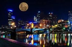 Melbourne Victoria Australia Cityscape at night taken from across the yarra river looking at the city. Supermoon over the City Melbourne Victoria, Victoria Australia, Visit Australia, Australia Travel, Stunning Photography, Travel Tours, New York Skyline, City Photo, Places To Go
