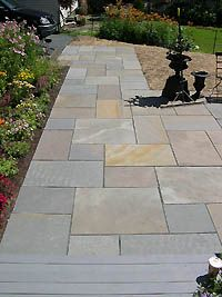 Bluestone tile.  Natural stone.  Honed, it made for a pretty, slip resistant, even surface to walk on.  Would love this for my patio.