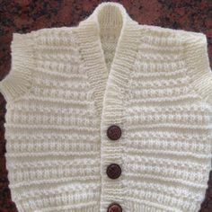 Garter Ridge Baby Cardigan in Lion Brand Cotton-Ease - 70351AD   Knitting Patterns   LoveKnitting