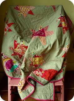 Baby Stars quilt. The soft green backing sets this quilt apart from a number of similar patterns