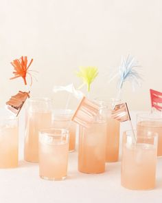Plexiglas stirrers add punch to signature drinks when they're decked out with petite pennants and pom-poms reminiscent of fireworks.