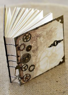 Steampunk Mixed Media Art Journal by OurLittleCottage on Etsy  Love this journal!  Lots of cool stuff inside! Www.ourlittlecottageshop.weebly.com