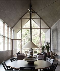 A world-traveling Seattle couple, enthusiasts of art and design, wanted todownsize their home and learn to live with less. They found a small forested pro