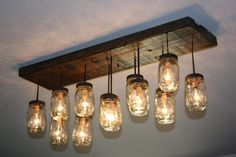 "The ""Coming Home"" Custom Mason Jar Chandelier. $400.00, via Etsy.  Custom made... I love this to add more light in the KITCHEN area and to tie into the new dining table..."