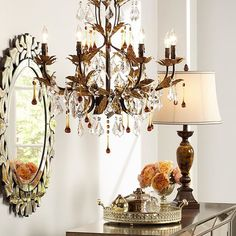 Create a glamorous home decor look with glittering golden bronze finishes, sparkling crystals and mirrored accents.