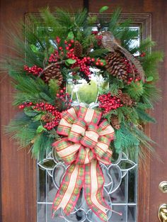 This 26 evergreen Christmas wreath features a beautiful pheasant. In addition, it is adorned with a plaid burlap bow, red berries and pinecones! This wreath is perfect for nature lovers! **LOCAL PICKUP IS AVAILABLE IN THE DFW AREA** **IF YOU LIVE OUTSIDE THE CONTINENTAL US, PLEASE CONTACT
