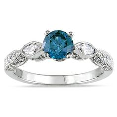 I think I just found my sister's ring. Must remember to tell whoever she ends up with. Miadora 14k White Gold Blue and White Diamond Engagement Ring (I1-I2)