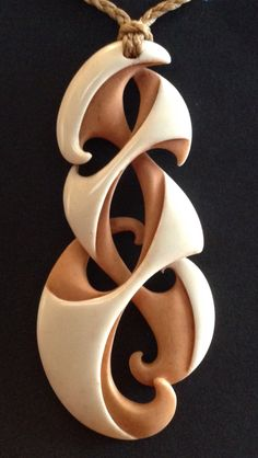 Whanau koru bone carving. Kerry Thompson.